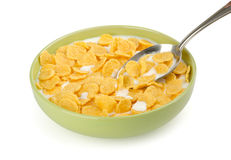 Bowl of corn flakes with milk. And spoon Royalty Free Stock Images