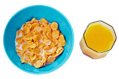 Bowl of corn flakes  with orange juice , top view Royalty Free Stock Photos
