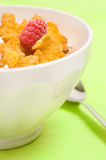 Bowl of corn flakes with raspberry Royalty Free Stock Photo