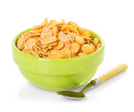 Bowl with corn flakes. On the white background Stock Photography