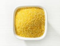 Bowl of corn grains Stock Images