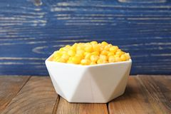 Bowl with corn kernels. On wooden table Stock Images