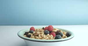 Bowl with corn rings and berries. Healthy breakfast Stock Photo