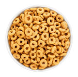 Bowl with corn rings isolated on white background. Cereals. Stock Photo