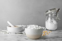 Bowl with corn starch. On marble table royalty free stock photo