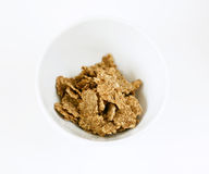 Bowl with cornflakes. On white background royalty free stock image