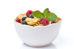 Bowl of cornflakes with berries and mint, isolated. Bowl of cornflakes with fresh berries and mint, isolated on white Royalty Free Stock Image