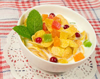 Bowl of cornflakes with candied fruit and berries Stock Image