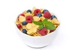 Bowl of cornflakes with fresh berries and mint, top view. Isolated on white Stock Image