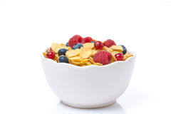 Bowl of cornflakes with fresh seasonal berries, isolated. On white Stock Image
