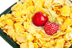 Bowl of cornflakes milk  cherry and strawberry Stock Photo