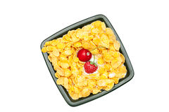 Bowl of cornflakes milk  cherry and strawberry Royalty Free Stock Photo