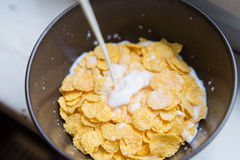 Bowl with Cornflakes and Milk. Healthy Breakfast. Stock Photo