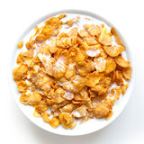 Bowl of cornflakes in milk isolated on white. Stock Images