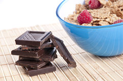 Bowl of cornflakes with raspberries and chocolate Stock Image