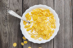 Bowl of cornflakes on the table Royalty Free Stock Image