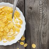 Bowl of cornflakes on the table Stock Image