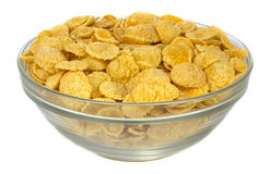 Bowl with cornflakes on white background stock photography