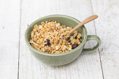 A bowl of cornflakes. On a white wood Royalty Free Stock Photography