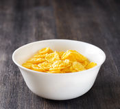Bowl of cornflakes on wooden table Stock Photography