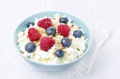 Bowl of cottage cheese with berries, honey, nuts for breakfast Stock Image