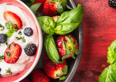 Bowl with cottage cheese,  blackberries, blueberries, strawberries and basil ,top view Royalty Free Stock Photo