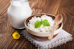 Bowl of cottage cheese and pitcher of milk Royalty Free Stock Images