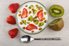Bowl with cottage cheese, slices of kiwi, strawberry and raisin Stock Images