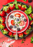 Bowl with cottage cheese, summer berries: blackberries, blueberries, strawberries and spoon, top view Stock Photography