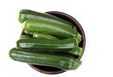 Bowl of courgettes. Wooden bowl containing fresh cut courgettes, a.k.a. zucchini Stock Image