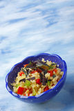 Bowl with couscous, chopped peppers and red basil Stock Images