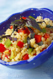 Bowl with couscous, chopped peppers and red basil Stock Photography