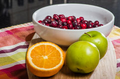 Bowl of cranberries with apples and oranges Royalty Free Stock Photos