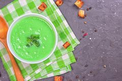 Bowl of cream of broccoli soup. Top view. Concept of healthy eating or vegetarian food.  royalty free stock photos