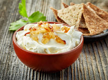 Bowl of cream cheese with caramelized onions Stock Photos