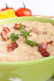 Bowl of Cream Corn Soup with Bacon. Close up Bowl of Cream Corn Soup with Crispy Bacon, Fresh Dill and Ingredients at the Back Royalty Free Stock Images