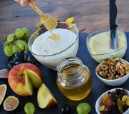 Bowl of cream curd sweetened with honey and fruits Royalty Free Stock Photo
