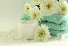 Bowl of cream, towel and flowers Royalty Free Stock Photo