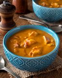 Creamy Lobster Bisque. A bowl of creamy delicious homemade lobster bisque stock photos