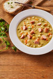 Bowl of Creamy Pea Soup with Chopped Sausage Royalty Free Stock Photo