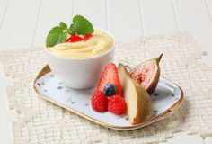 Bowl of creamy pudding and fresh fruit Royalty Free Stock Image