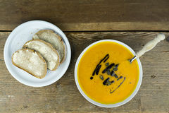 Bowl of creamy pumpkin soup Royalty Free Stock Images