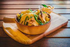 Bowl of crispy nachos. On a wooden plate and table Stock Photos