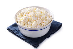 Bowl of crumbly cottage cheese Stock Image