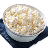 Bowl of crumbly cottage cheese Stock Photography