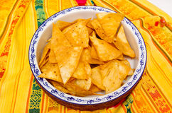Bowl of crunchy delicous tortilla chips sitting on native american table cloth Stock Images