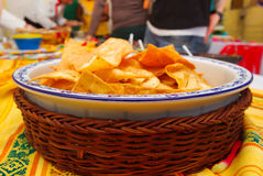 Bowl of crunchy delicous tortilla chips sitting on native american table cloth Royalty Free Stock Images