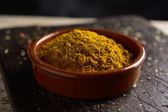 Bowl with curry powder Stock Photos