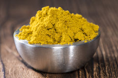 Bowl with Curry Powder Royalty Free Stock Image