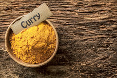 Bowl of curry powder Stock Photos